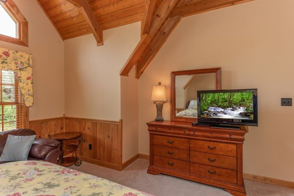 Dresser and TV in the loft bedroom at Mountain Lake Getaway, a 3 bedroom cabin rental located at Douglas Lake