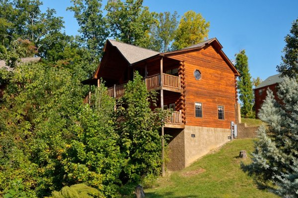 Looking back at the cabin with the trees in front at Kick Back & Relax! A 4 bedroom cabin rental located in Pigeon Forge