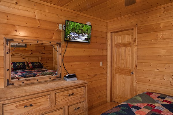 Dresser with a mirror and tv at Kick Back & Relax! A 4 bedroom cabin rental located in Pigeon Forge