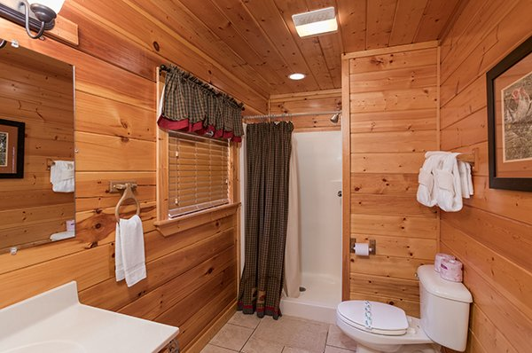Third bathroom with a shower stall at Kick Back & Relax! A 4 bedroom cabin rental located in Pigeon Forge