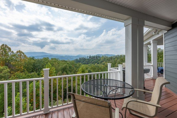 Bistro set dining on the porch at Summit Glory, a 5 bedroom cabin rental located in Pigeon Forge