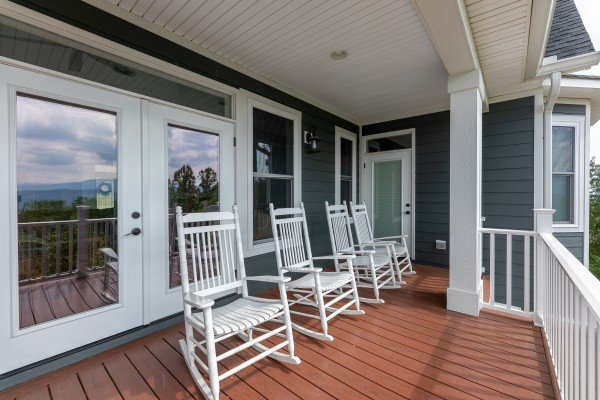 Rocking chairs on the deck at Summit Glory, a 5 bedroom cabin rental located in Pigeon Forge