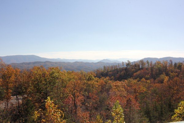 The Smoky Mountains with fall colors at Summit Glory, a 5 bedroom cabin rental located in Pigeon Forge