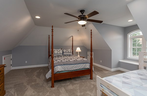 Upstairs bedroom with a 4 post bed at Summit Glory, a 5 bedroom cabin rental located in Pigeon Forge