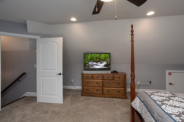 Fifth bedroom with dresser and TV at Summit Glory, a 5 bedroom cabin rental located in Pigeon Forge