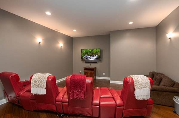 Home theater room with four large recliners at Summit Glory, a 5 bedroom cabin rental located in Pigeon Forge
