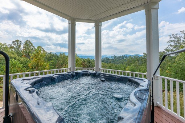 Hot tub on the deck at Summit Glory, a 5 bedroom cabin rental located in Pigeon Forge