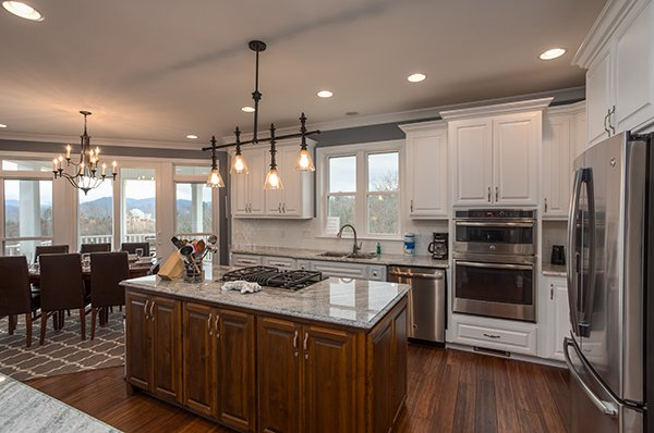 Kitchen island with granite counters and stainless appliances at Summit Glory, a 5 bedroom cabin rental located in Pigeon Forge