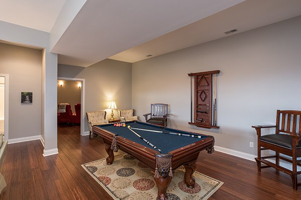 Pool table on the first floor at Summit Glory, a 5 bedroom cabin rental located in Pigeon Forge