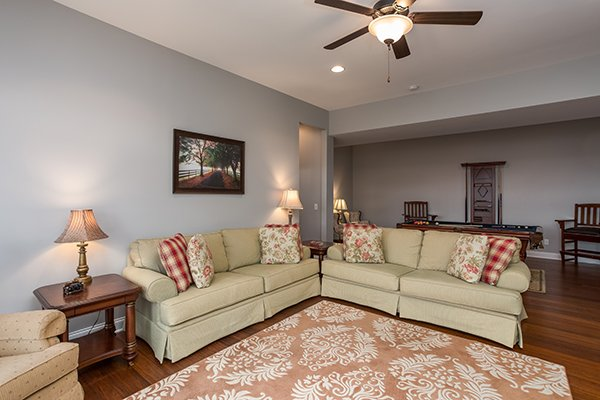 Living room on the first floor with two sofas at Summit Glory, a 5 bedroom cabin rental located in Pigeon Forge