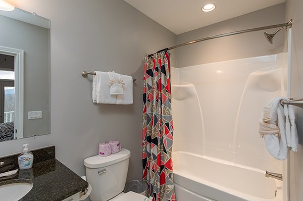 Bathroom with a tub and shower at Summit Glory, a 5 bedroom cabin rental located in Pigeon Forge