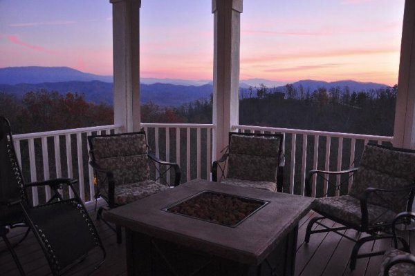 Fire pit on the deck at sunset at Summit Glory, a 5 bedroom cabin rental located in Pigeon Forge