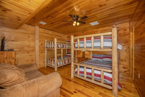 Room with four bunks at Hickernut Lodge, a 5-bedroom cabin rental located in Pigeon Forge