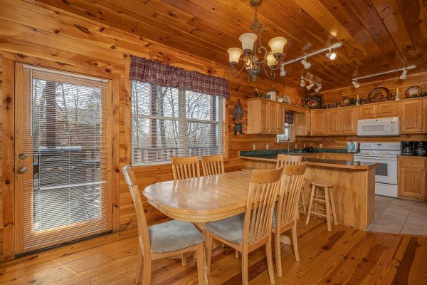 Dining table for six at Hickernut Lodge, a 5-bedroom cabin rental located in Pigeon Forge