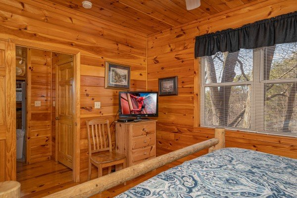 Bedroom with dresser and TV at Hickernut Lodge, a 5-bedroom cabin rental located in Pigeon Forge