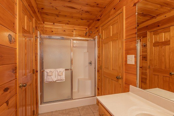 Bathroom with shower at Hickernut Lodge, a 5-bedroom cabin rental located in Pigeon Forge