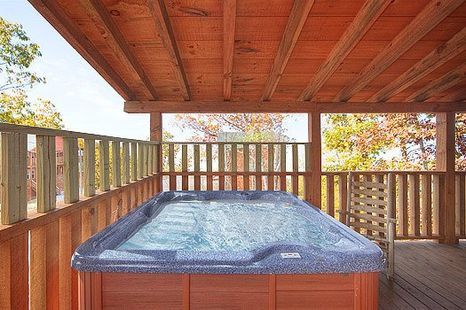 Hot tub on deck at Hickernut Lodge, a 5-bedroom cabin rental located in Pigeon Forge