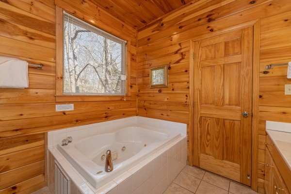 Bathroom with a jacuzzi at Hickernut Lodge, a 5-bedroom cabin rental located in Pigeon Forge