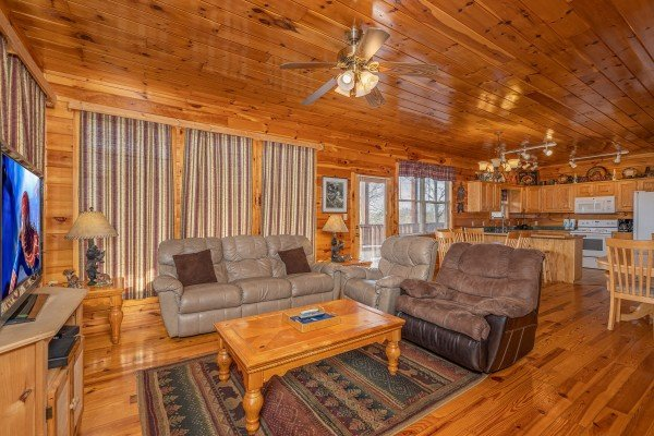 Seating in the main living room at Hickernut Lodge, a 5-bedroom cabin rental located in Pigeon Forge