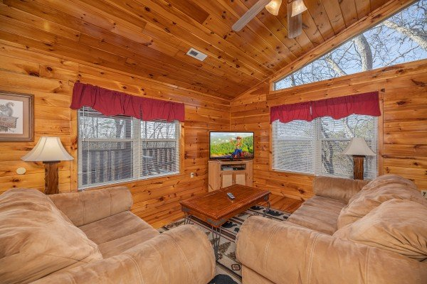 Loft living space with TV at Hickernut Lodge, a 5-bedroom cabin rental located in Pigeon Forge