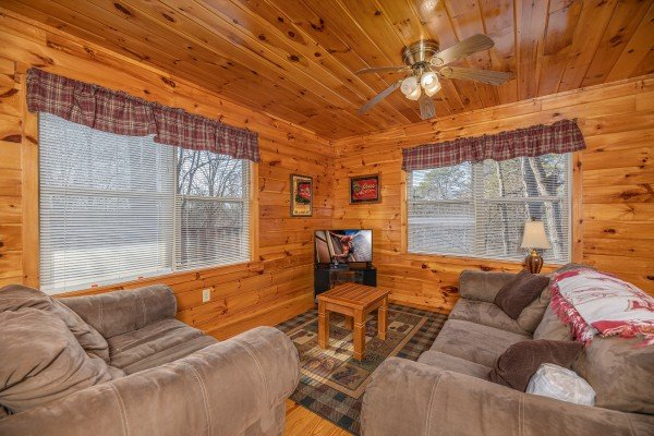 Lower living room at Hickernut Lodge, a 5-bedroom cabin rental located in Pigeon Forge