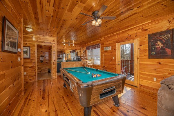 Pool table in the lower living room at Hickernut Lodge, a 5-bedroom cabin rental located in Pigeon Forge