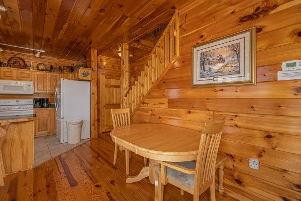 Dining table for two at Hickernut Lodge, a 5-bedroom cabin rental located in Pigeon Forge