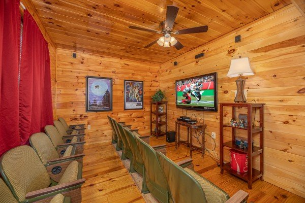 Theater room at Hickernut Lodge, a 5-bedroom cabin rental located in Pigeon Forge