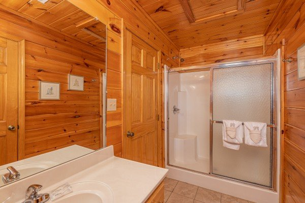 Bathroom with a shower at Hickernut Lodge, a 5-bedroom cabin rental located in Pigeon Forge