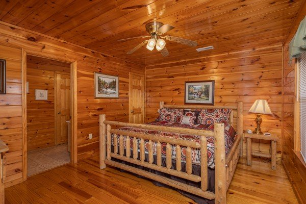 Bedroom with a log bed at Hickernut Lodge, a 5-bedroom cabin rental located in Pigeon Forge