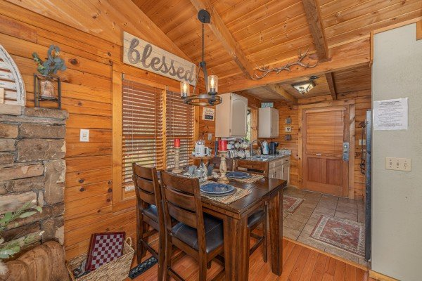 Dining table for four at Snuggle Inn, a 2 bedroom cabin rental located in Pigeon Forge