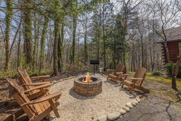 Fire pit in the yard at Snuggle Inn, a 2 bedroom cabin rental located in Pigeon Forge