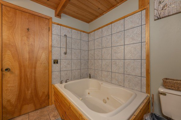 Jacuzzi tub in a bathroom at Snuggle Inn, a 2 bedroom cabin rental located in Pigeon Forge