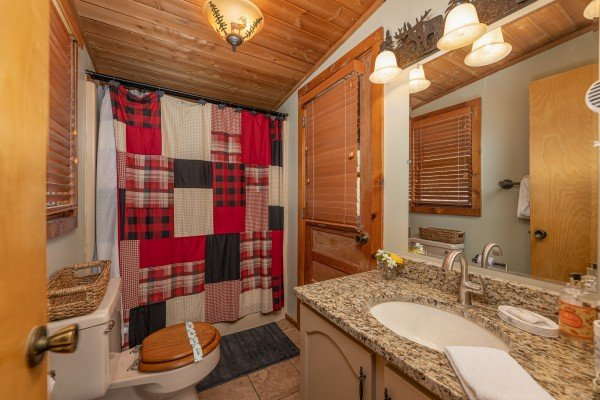 Bathroom with a tub and shower at Snuggle Inn, a 2 bedroom cabin rental located in Pigeon Forge