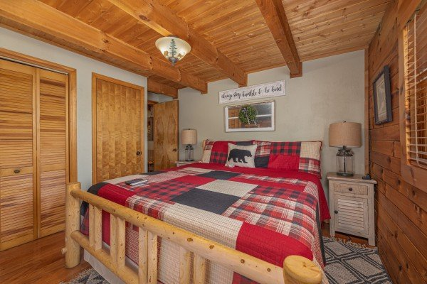 Log bed, two night stands, and lamps at Snuggle Inn, a 2 bedroom cabin rental located in Pigeon Forge