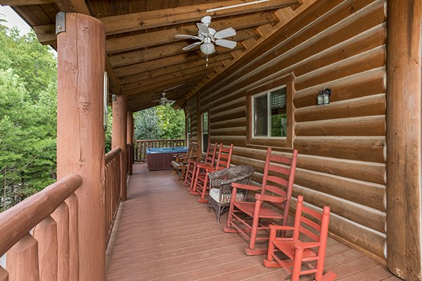 Rocking chairs on the covered deck at Longwalker Lodge, a 3 bedroom cabin rental located in Pigeon Forge