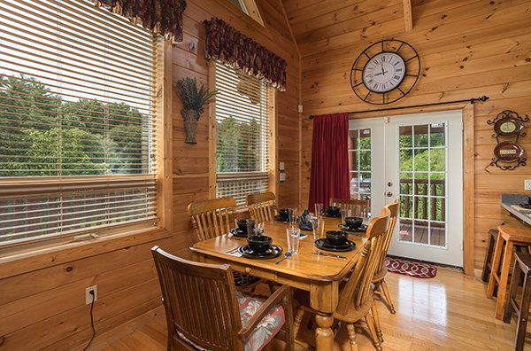 Dining table for six at Longwalker Lodge, a 3 bedroom cabin rental located in Pigeon Forge