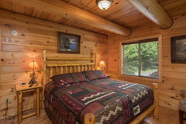 Bedroom with a king sized bed at Longwalker Lodge, a 3 bedroom cabin rental located in Pigeon Forge