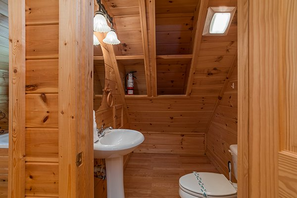 Half bath on the upper floor at Longwalker Lodge, a 3 bedroom cabin rental located in Pigeon Forge