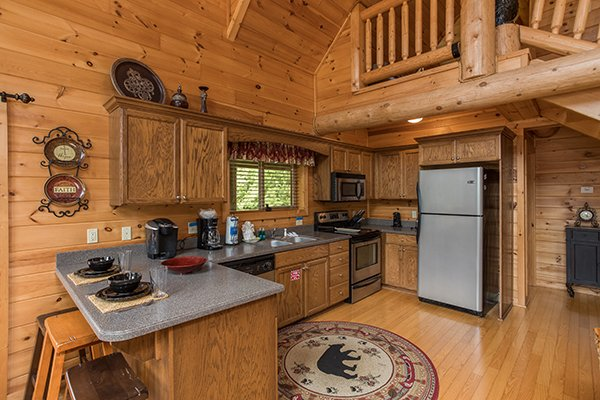 Kitchen with stainless appliances at Longwalker Lodge, a 3 bedroom cabin rental located in Pigeon Forge