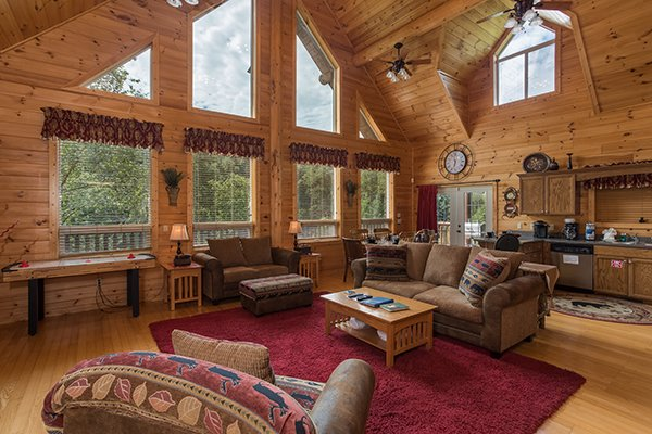 Living room, dining space, and kitchen on an open concept main floor at Longwalker Lodge, a 3 bedroom cabin rental located in Pigeon Forge