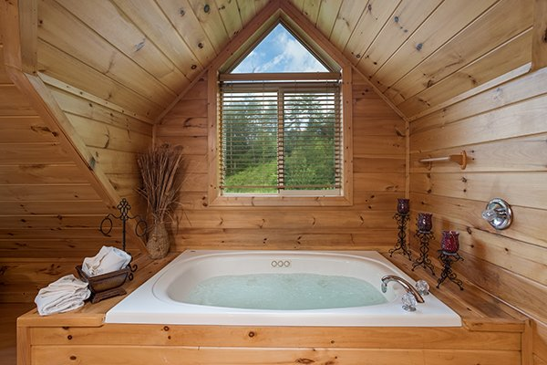 Jacuzzi tub in the loft space at Longwalker Lodge, a 3 bedroom cabin rental located in Pigeon Forge