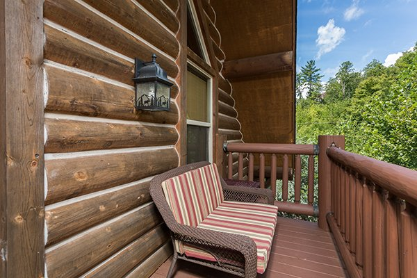 Bench seating on the upper deck at Longwalker Lodge, a 3 bedroom cabin rental located in Pigeon Forge