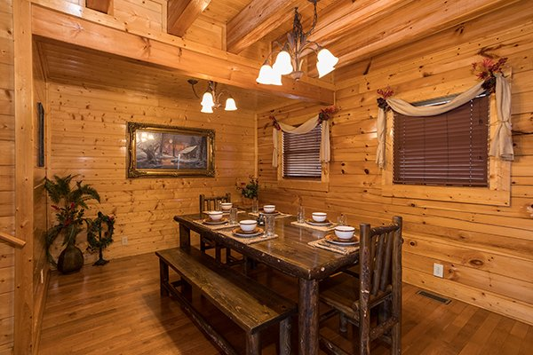 Dining space for six at Grand Timber Lodge, a 5-bedroom cabin rental located in Pigeon Forge