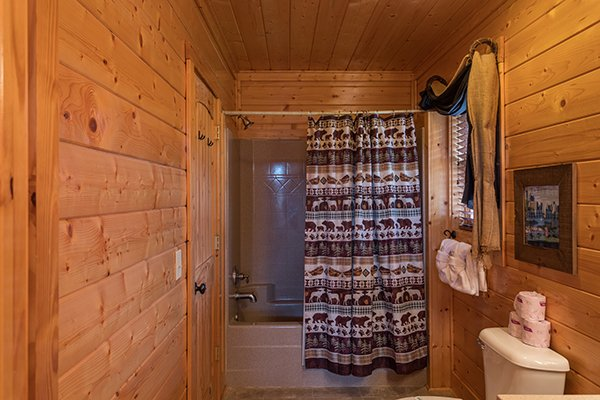 Bathroom with a tub and shower at Grand Timber Lodge, a 5-bedroom cabin rental located in Pigeon Forge