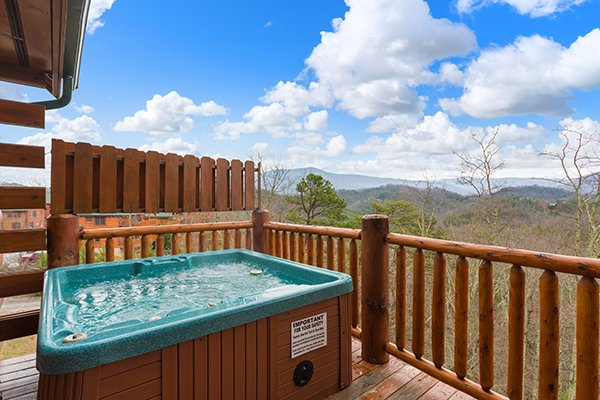 Hot tub with privacy fence and mountain views at Grand Timber Lodge, a 5-bedroom cabin rental located in Pigeon Forge