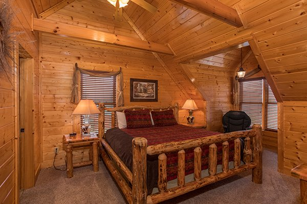 Loft space with a king-sized log bed at Grand Timber Lodge, a 5-bedroom cabin rental located in Pigeon Forge
