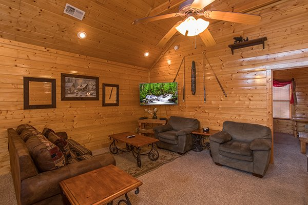 Sleeper sofa and two chairs in the game loft at Grand Timber Lodge, a 5-bedroom cabin rental located in Pigeon Forge