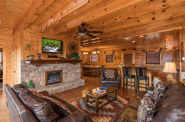 Main floor living room at Grand Timber Lodge, a 5-bedroom cabin rental located in Pigeon Forge