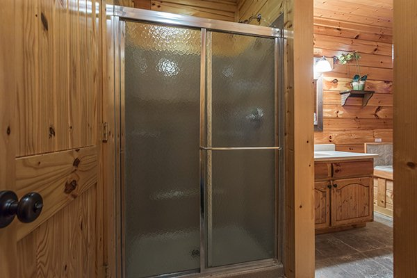 Bathroom with a shower and separate tub at Grand Timber Lodge, a 5-bedroom cabin rental located in Pigeon Forge
